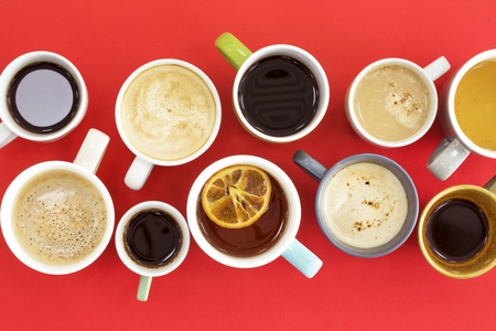 Different cups of coffee on red background Stock Photo