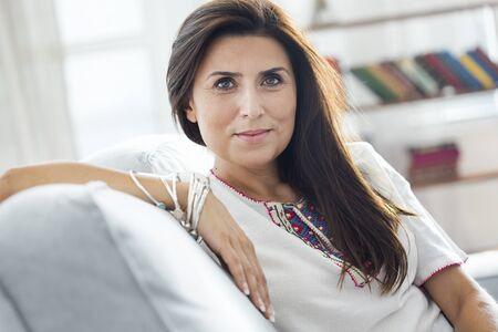 Beautiful young woman look at camera Stockfoto