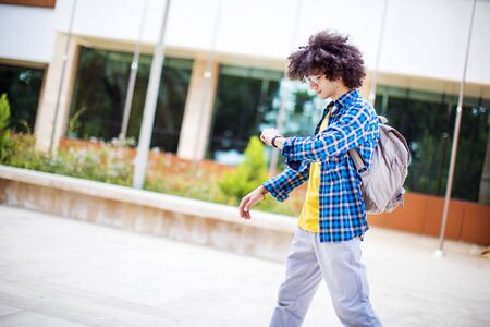 Young man is late to the school Stock fotó