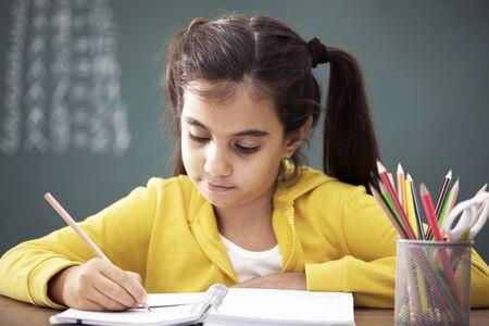 School child in classroom