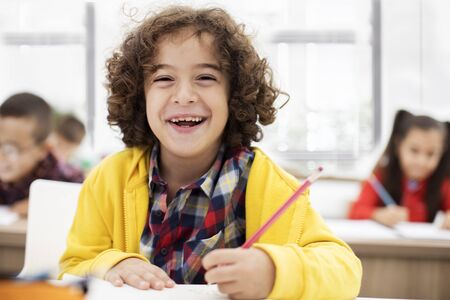 School children in classroom Stock Photo