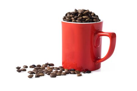 Granul coffee beans in red coffee cup and floor on the white background Archivio Fotografico