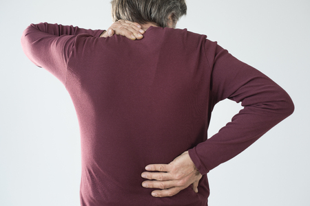 Elderly man has back and neck pain