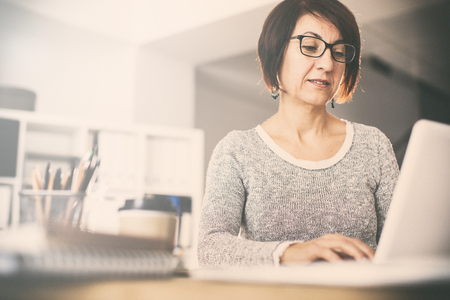Middle age woman using computer