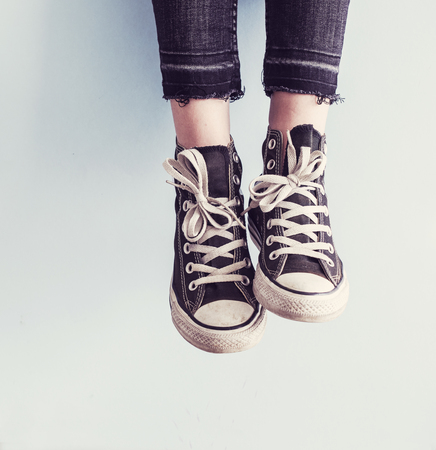 Woman wear black sneaker shoes