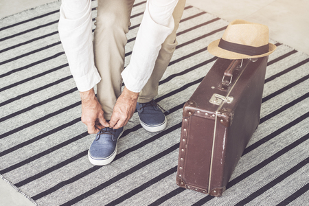 Man with luggage leaving home for a holiday