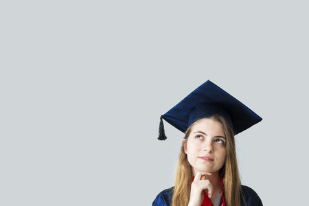 Young female student graduating from university