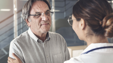 Health worker talking to the patient Stock Photo