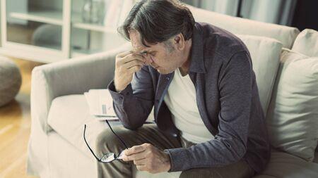 Senior man with headache Stock Photo