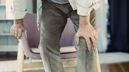 Old man with knee pain