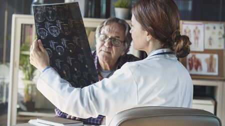 Doctor with patient in medical office