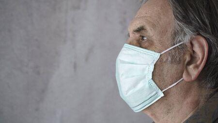 Old man wearing medical mask