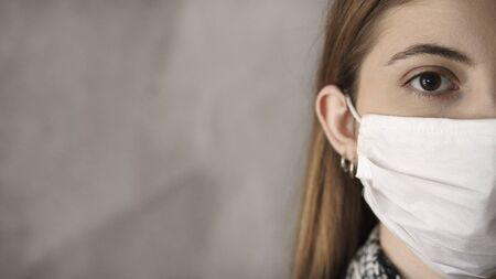 Young woman wearing medical mask Archivio Fotografico