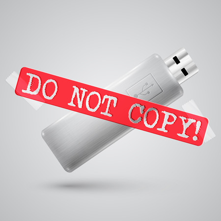 pendrive: A metal pendrive with a warning sign
