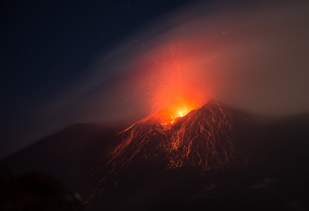 Eruption of the Etna volcano from the active central crater with lava explosion Фото со стока - 87874170