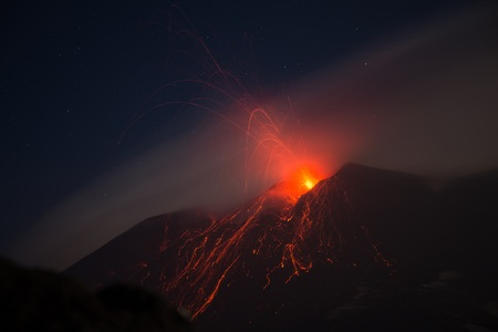 Eruption of the Etna volcano from the active central crater with lava explosion