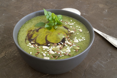 Vegetarian spinach soup with sesame seeds and flax.