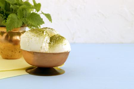 Ice cream with matcha tea and mint.