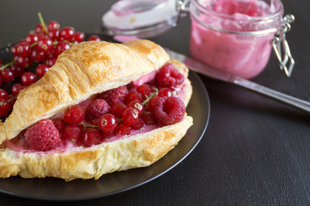 Croissants with jam and berries for Breakfast.