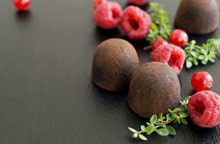 Chocolate truffles on a gray background.