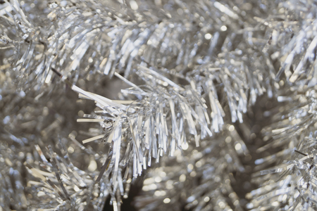 Artificial silver tree close-up. Christmas background