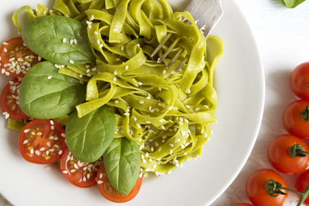 spinach tagliatelle with cherry tomatoes. proper diet.
