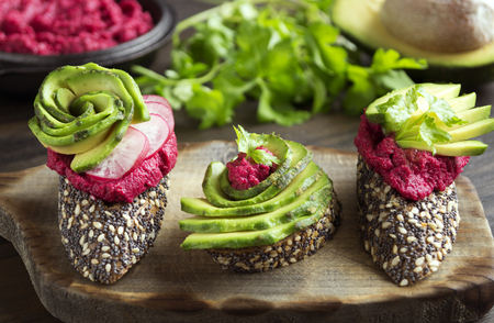 useful sandwiches with beet hummus and avocado