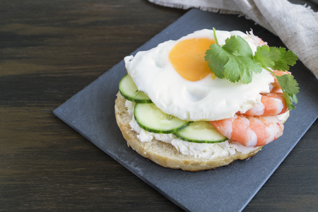 egg and cucumber sandwich on wooden background.
