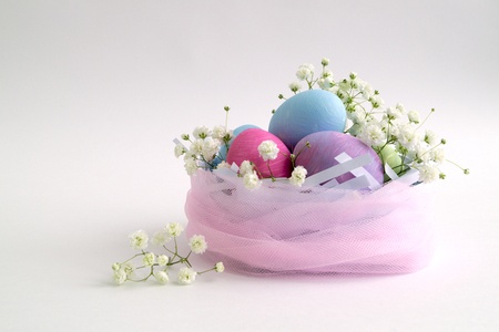 Easter color painted eggs on a white background. Stock Photo