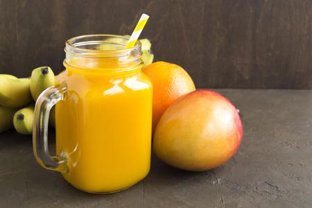Fresh fruit juice in the jar. on dark background. Stok Fotoğraf