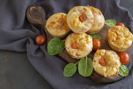 homemade cheese muffins on a dark background.