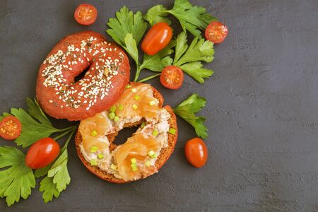 red bagel with salmon pate and smoked salmon