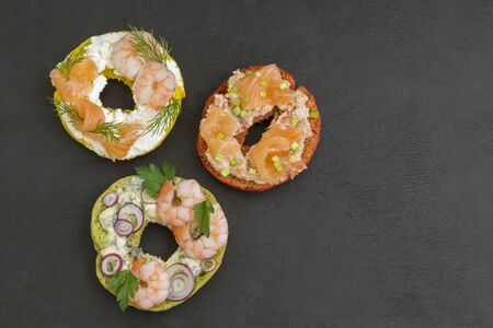 Bagels with cream cheese, salmon,  shrimp. On a black background. 写真素材 - 137799867