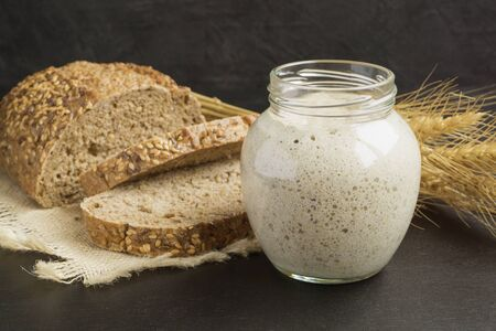 Active rye sourdough in a glass jar for homemade bread.