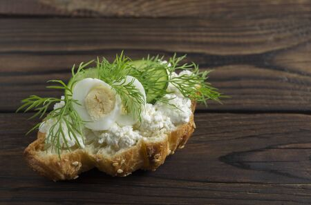 Croissant with cheese and herbs. on dark background