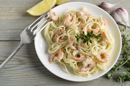 spaghetti with prawns in cream sauce. traditional Italian cuisine.