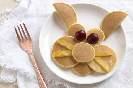 Funny rabbit pancakes with fruit for kids Breakfast
