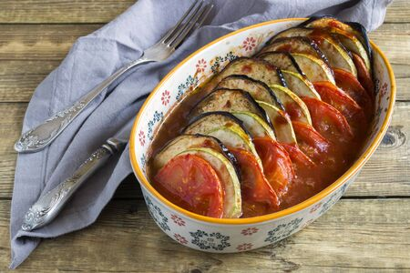 Ratatouille. traditional French vegetable stew. on a wooden table.