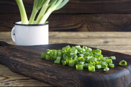 young green sliced onions. on a wooden Board