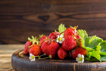 ripe fresh strawberries. berry harvest on a wooden background