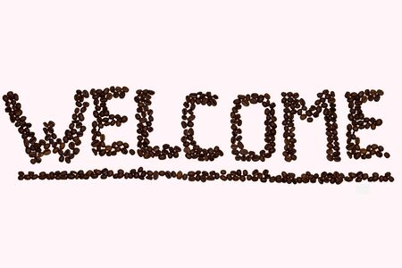 in lined: inscription Wellcome lined with coffee beans Stock Photo