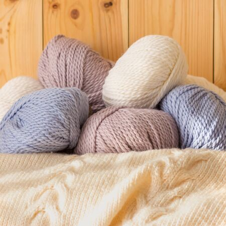 variegated: Thin fluffy skeins of wool for knitting a pale pink, blue and beige colors