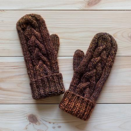 mittens: warm cozy knitted handmade mittens Stock Photo