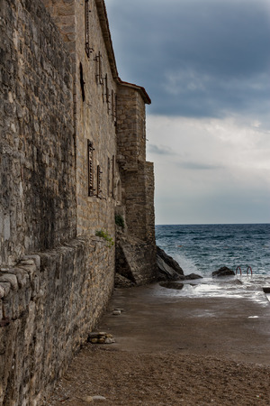 Waves breaking on the stone walls of the old fortress Stock Photo