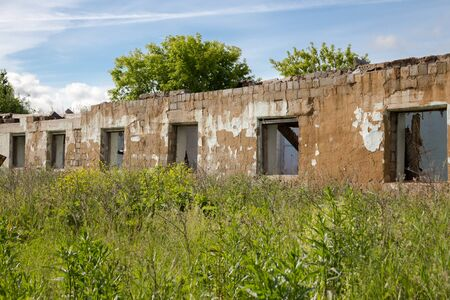 An old abandoned building without a roof in the village near the Ural, Russia. Stock Photo