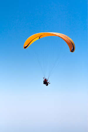 Sky Diving with space in solid blue sky Stock Photo