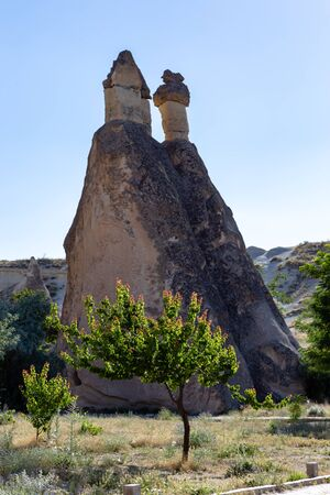 Magic fungous forms of sandstone in the canyon near Cavusin village, Cappadocia, Nevsehir Province in the Central Anatolia Region of Turkey, Asia. Beauty of nature concept background.
