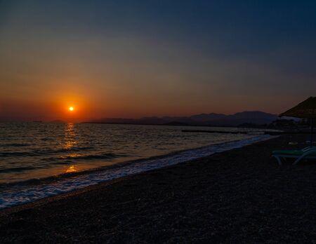 Sunset on the Calis Beach on the Aegean Sea. FETHIYE, TURKEY