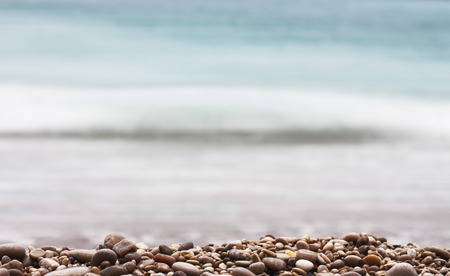 gravel depth of field with sea background theme