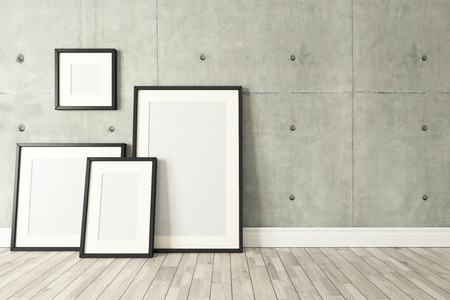 Blank picture frames with concrete wall and wooden parquet decor like loft style, background, template design